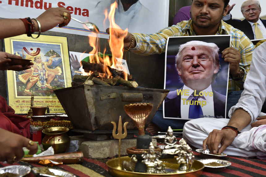 NEW DELHI, INDIA - MAY 11: Hindu Sena activists organize a hawan and chant mantras invoking the Hindu Gods to help Republican candidate Donald Trump to win the US presidential election at Jantar Mantar on May 11, 2016 in New Delhi, India. While Trump has dominated the Republican primary race to decide the party's candidate for the November election, his calls for temporarily banning Muslims from America and cracking down on terrorist groups abroad have earned him some fans in faraway India. (Photo by Arvind Yadav/Hindustan Times via Getty Images)