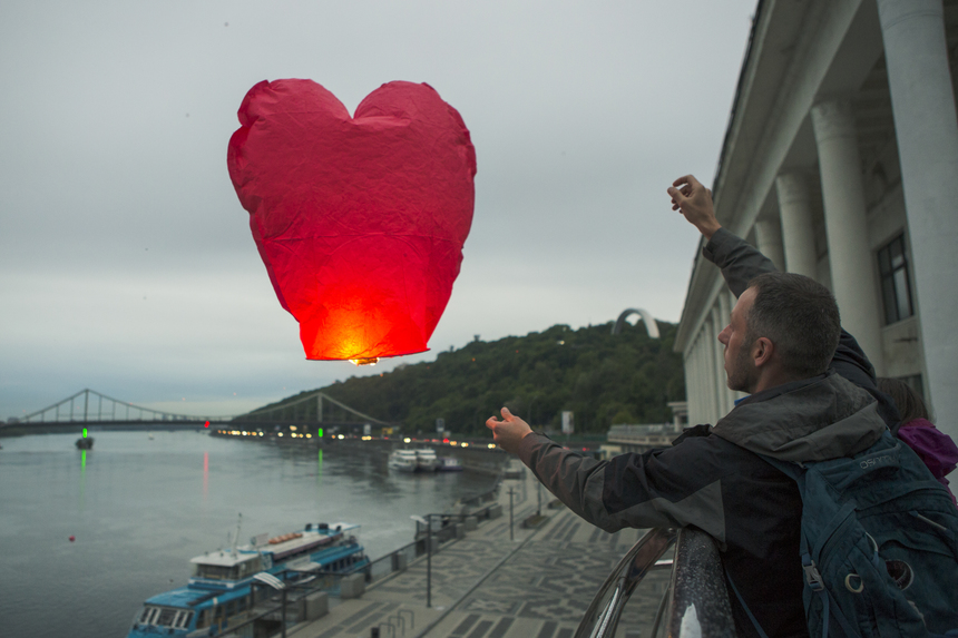 Man launch sky lanterns to mark the 35th birthday of Ukrainian military pilot, Nadiya Savchenko, who is detained in a Russian prison, on May 11, 2016, in Kiev. Savchenko was sentenced to 22 years in jail by a Russian court in March after being convicted of the murder of two Russian journalists who died covering the pro-Moscow rebellion in eastern Ukraine.  (Photo by Oleg Pereverzev/NurPhoto via Getty Images)