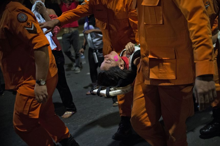 TOPSHOT - A woman is carried on a stretcher during a demo against the impeachment of Brazilian President Dilma Rousseff in front of the National Congress in Brasilia on May 11, 2016.   Brazil's Senate opened debate Wednesday ahead of a vote on suspending President Dilma Rousseff and launching an impeachment trial that could bring down the curtain on 13 years of leftist rule in Latin America's biggest country. Even allies of Rousseff, 68, said she had no chance of surviving the vote. / AFP / ANDRESSA ANHOLETE        (Photo credit should read ANDRESSA ANHOLETE/AFP/Getty Images)
