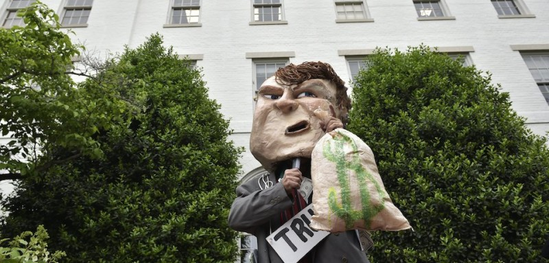 A demonstrator wearing a Trump head protests outside of the Republican National Committee where Republican presidential candidate Donald Trump will meet party leaders on Capitol Hill in Washington, DC on May 12, 2016. / AFP / Mandel NGAN        (Photo credit should read MANDEL NGAN/AFP/Getty Images)
