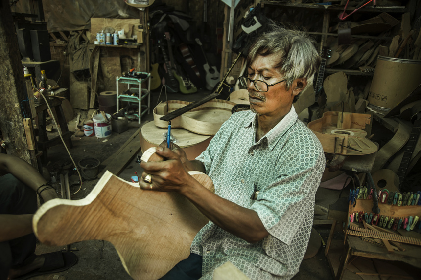 Hadi Waluyo (58) check mahagony wood when making guitar in Zianturi Guitar Equipments, Paingan, Yogyakarta, Indonesia, on May 11, 2016. Hadi Waluyo establish Zianturi Guitar Equipments in 1993 to create acoustic and electric guitars with the use wood like rosewood, mahogani, maple, ash, eboni dan alder. This time made guitar brand Hadi Waluyo Zianturi often used by musician in Indonesia. Besides working on booking local musicinas, Hadi Waluyo also sent the results of his work to Germany, Russia, Canada, Croatia, Netherlands, Phlipines, Australia and Malaysia at a price of IDR. 1,7 million - IDR. 24 million for one guitar.(Photo by Pradita Utana/NurPhoto via Getty Images)