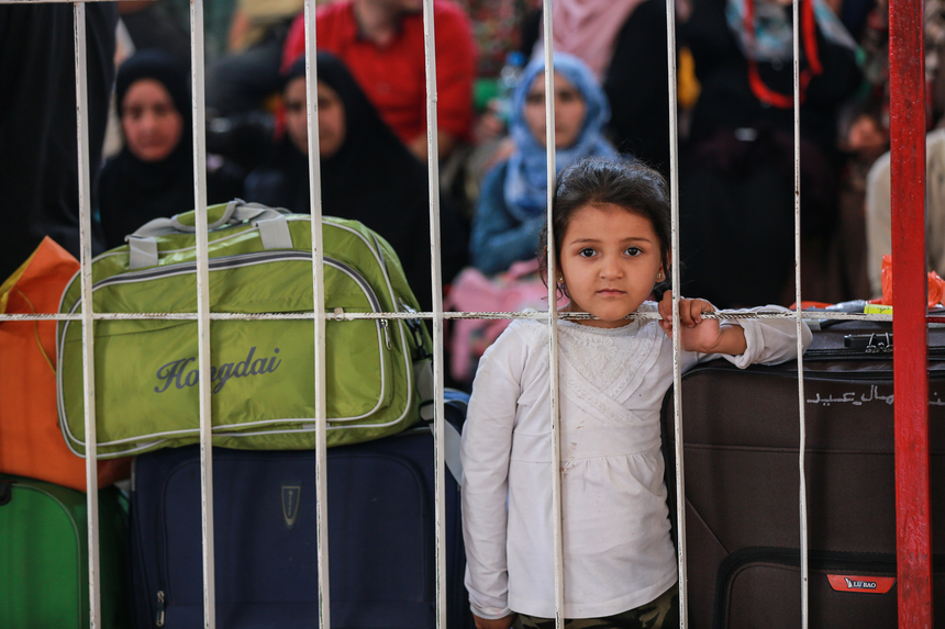 A child  wait with his family for a travel permit to cross into Egypt through the Rafah border crossing, which is Gaza's only access to the outside world, after Egyptian authorities reopened in two directions for two days in Gaza City, Gaza on May 12, 2016. Students, patients, people with residence permit and passport owners are allowed to cross to border. (Photo by Hosam Salem/NurPhoto via Getty Images)