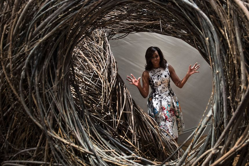 US First Lady Michelle Obama looks at Patrick Dougherty's Shindig at the Smithsonian's Renwick Gallery May 13, 2016 in Washington, DC. / AFP / Brendan Smialowski / RESTRICTED TO EDITORIAL USE - MANDATORY MENTION OF THE ARTIST UPON PUBLICATION - TO ILLUSTRATE THE EVENT AS SPECIFIED IN THE CAPTION        (Photo credit should read BRENDAN SMIALOWSKI/AFP/Getty Images)