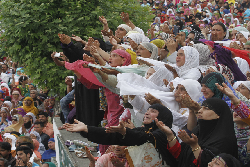 SRINAGAR, INDIA - MAY 13: Kashmiri women pray as a head priest (not in picture) displays a holy relic believed to be the hair from the beard of Prophet Mohammed, at the Hazratbal Shrine on the outskirts of on May 13, 2016 in Srinagar, India. Devotees thronged to the Hazratbal Shrine on the following Friday of the Muslim festival Mehraj-u-Alam, believed to mark the ascension of Prophet Mohammed to Heaven.(Photo by Waseem Andrabi/Hindustan Times via Getty Images)