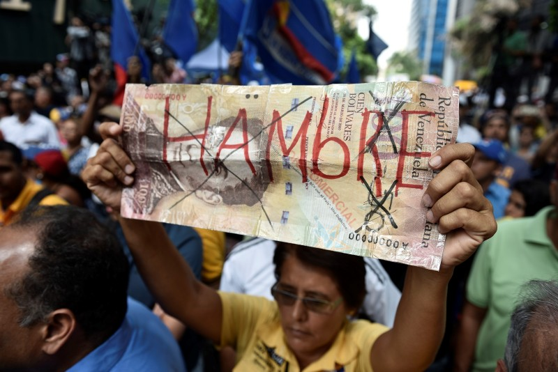 CARACAS - VENEZUELA, MAY 25: Protesters holding banners during an anti-government demonstration outside the Supreme Tribunal of Justice (TSJ) in Caracas, Venezuela on May 25, 2016. Protesters seeking to drive Venezuela's President Nicolas Maduro from office launched fresh street rallies. (Photo by Carlos Becerra/Anadolu Agency/Getty Images)