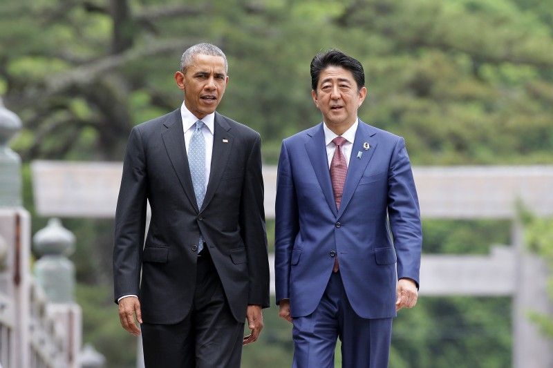ISE, JAPAN - MAY 26:  (L to R) U.S. President Barack Obama walks with Japanese Prime Minister Shinzo Abe on the Ujibashi bridge as they visit at the Ise-Jingu Shrine on May 26, 2016 in Ise, Japan. In the two-day summit, the G7 leaders are scheduled to discuss global issues including counter-terrorism, energy policy, and sustainable development.  (Photo by Chung Sung-Jun/Getty Images)