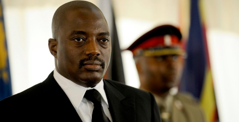 Democratic Republic of Congo (DRC) President Joseph Kabila looks on at the 32nd summit of the Southern African Development Community (SADC) at Maputo's Joaquim Chissano Conference Centre on August 17, 2012 in Maputo. During their two day meeting the heads of the 15 nation bloc will turn their attention to conflict in the Democratic Republic of Congo as well as the the border dispute between Malawi and Tanzania. A quarter of a million people have fled the eastern DRC since April when a rebel group calling itself the M23 took up arms against the government. AFP PHOTO / STEPHANE DE SAKUTIN        (Photo credit should read STEPHANE DE SAKUTIN/AFP/GettyImages)