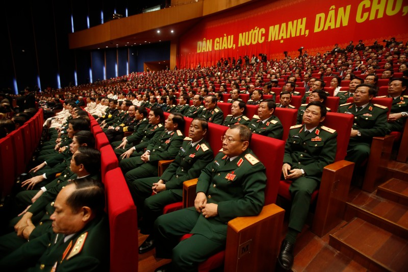 Military delegates attend the closing ceremony on the final day of the Vietnam Communist Party's 12th National Congress in Hanoi on January 28, 2016. Vietnam's top communist leader Nguyen Phu Trong was re-elected on January 27 in a victory for the party's old guard which some fear could slow crucial economic reforms in the fast-growing country.      AFP PHOTO / POOL / Kham / AFP / POOL / KHAM.        (Photo credit should read KHAM./AFP/Getty Images)