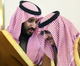 Saudi Defence Minister Mohamed bin Salman (L) talks with Crown Prince and Interior Minister Mohammed bin Nayef during the 136th Gulf Cooperation Council (GCC) summit, in the Saudi capital Riyadh, on December 9, 2015. Gulf monarchs began arriving in Saudi Arabia for an annual summit, facing challenges including plunging oil revenues, the war in Yemen, pressure for peace in Syria and signs of regional divisions.   / AFP / FAYEZ NURELDINE        (Photo credit should read FAYEZ NURELDINE/AFP/Getty Images)