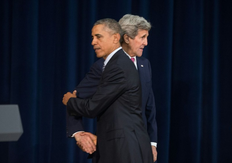 US President Barack Obama is greeted by Secretary of State John Kerry before he addresses the Chief of Missions conference at the State Department in Washington, DC, on March 14, 2016. / AFP / Nicholas Kamm        (Photo credit should read NICHOLAS KAMM/AFP/Getty Images)
