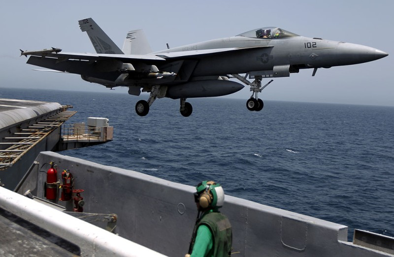An F-18 jet fighter flies out of the USS Eisenhower aircraft carrier in the Arabian sea on May 24, 2010. The USS Eisenhower is on a mission to support US-led coalition forces in Afghanistan.   AFP PHOTO/MARWAN NAAMANI (Photo credit should read MARWAN NAAMANI/AFP/Getty Images)