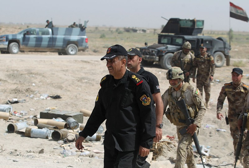 Iraqi army general in charge of the Fallujah operation Abdel Wahab al-Saadi (C) walks among troops in an area on the southern outskirts of Fallujah on June 1, 2016 during fighting against jihadists of the Islamic State (IS) group. Iraqi forces launched an offensive a week ago to recapture Fallujah, which became an IS group stronghold after its fighters seized the city in January 2014. / AFP / AHMAD AL-RUBAYE        (Photo credit should read AHMAD AL-RUBAYE/AFP/Getty Images)