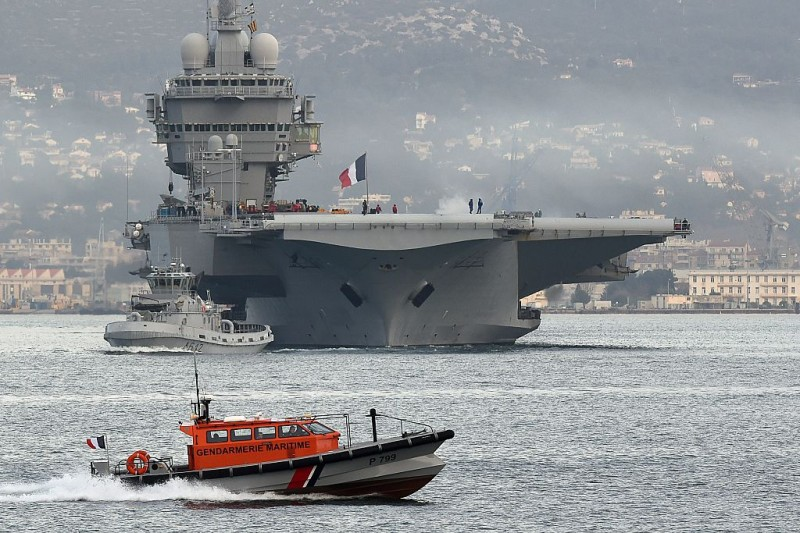 French aircraft carrier Charles-de-Gaulle sets sail from the southern French port of Toulon on January 13, 2015 before taking part in military operations in the Gulf.   AFP PHOTO / BORIS HORVAT        (Photo credit should read BORIS HORVAT/AFP/Getty Images)