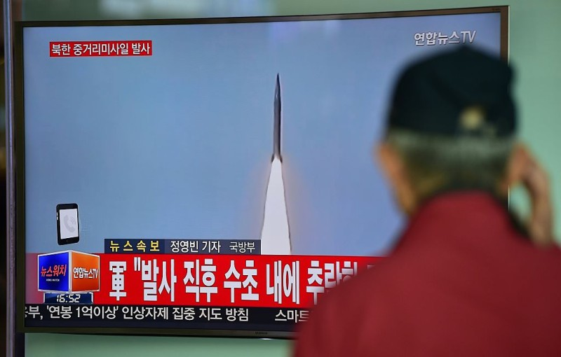 A man watches a TV news showing file footage of a North Korean missile launch at a railway station in Seoul on April 28, 2016. North Korea on April 28 tried and failed in what appeared to be its second attempt in two weeks to test a powerful, new medium-range ballistic missile, South Korea's defence ministry said. / AFP / JUNG YEON-JE        (Photo credit should read JUNG YEON-JE/AFP/Getty Images)
