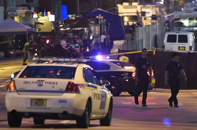 Lights from police vehicles light up the scene infront of the Pulse club in Orlando, Florida on June 12, 2016.  Fifty people died when a gunman allegedly inspired by the Islamic State group opened fire inside a gay nightclub in Florida, in the worst terror attack on US soil since September 11, 2001. / AFP / Mandel Ngan        (Photo credit should read MANDEL NGAN/AFP/Getty Images)