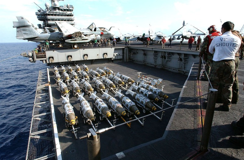 AT SEA - MARCH 21:  In this Navy handout photo, 2000 pound GBU-31 Joint Direct Attack Munitions (JDAM) are transported to the flight deck of the USS Harry S. Truman March 21, 2003 in the Mediterranean Sea. The bombs will be loaded onto fighter jets to support the war in Iraq.  (Photo by U.S. Navy/ Michael W. Pendergrass/Getty Images)