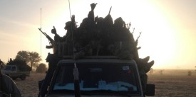 Soldiers of the Chadian army guard on January 21, 2015, at the border between Nigeria and Cameroon, some 40 km from Maltam, as part of a military contingent against the armed Islamist group Boko Haram. Chad, seen as having the most capable military in the region, sent on January 17-18, 2015 a convoy of troops and 400 military vehicles into neighbouring Cameroon to battle Boko Haram. AFP PHOTO / ALI KAYA        (Photo credit should read ALI KAYA/AFP/Getty Images)
