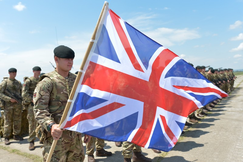 Members of the British Units during the opening ceremony of the Exercise Noble Partner 16, a Georgian, British and U.S. military training exercise taking place at Vaziani Training Area, Georgia, May 11-26, 2016. Exercise Noble Partner includes approximately 500 Georgian, 150 United Kingdom and 650 U.S. service members who are incorporating a full range of equipment, including U.S. M1A2 Abrams Main Battle Tanks, M2A3 Bradley Infantry Fighting Vehicles, M119 Light Towed Howitzers and several wheeled support vehicles. Alongside U.S. forces, Georgian forces will operate their T-72 Main Battle Tanks, BMP-2 Infantry Combat Vehicles and several wheeled-support vehicles. Wednesday, 11 May 2016, in Vaziani, Georgia. (Photo by Artur Widak/NurPhoto via Getty Images)