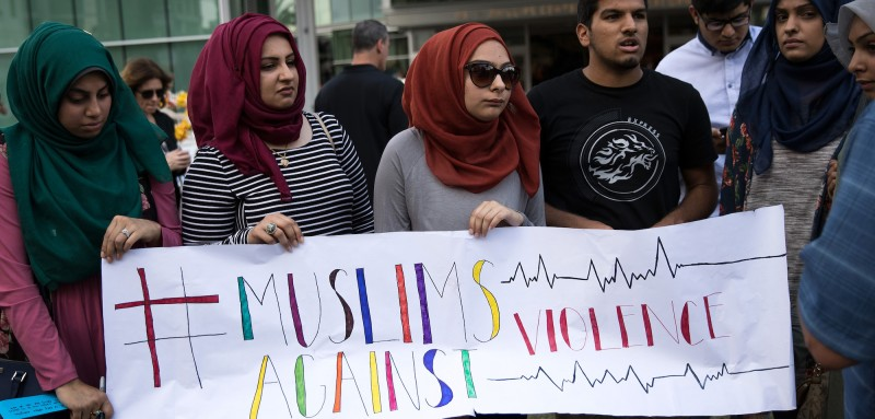 ORLANDO, FL - JUNE 14: Young people from Husseini Islamic Center in Sanford, Florida hold up a sign as they visit a makeshift memorial at the Dr. Phillips Center for Performing Arts, June 14, 2016 in Orlando, Florida. The shooting at Pulse Nightclub, which killed 49 people and injured 53, is the worst mass-shooting event in American history. (Photo by Drew Angerer/Getty Images)