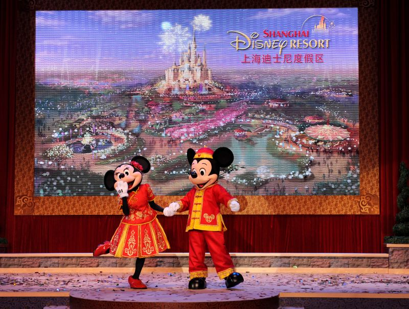 SHANGHAI, CHINA - APRIL 08:  In this handout photo provided by Disney Parks, dressed in traditional Chinese costumes, Minnie Mouse and Mickey Mouse acknowledge the crowd in Shanghai April 8, 2011 during the official groundbreaking ceremony for the Shanghai Disney Resort in Shanghai, China.  The Shanghai Disney Resort, the first Disney resort in mainland China, is slated to open in approximately five years. (Photo by David Roark/Disney Parks via Getty Images)