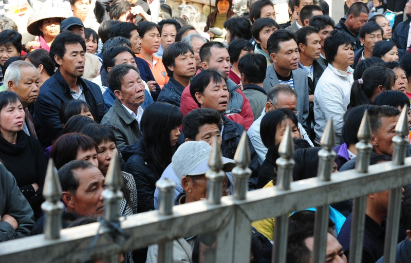 Villagers listen to the meeting where an envoy from the Shanwei Communist Party Committee met with Wukan village leaders, as they demand the government take action over illegal land grabs and the death in custody of a local leader on in Wukan, Guangdong on December 19, 2011.  The village of around 13,000 inhabitants accuse local officials of stealing communal land without compensating them with anger boiling over with the death in police custody of a village leader tasked with negotiating with authorities over the row.            AFP PHOTO/CHINA OUT (Photo credit should read STR/AFP/Getty Images)