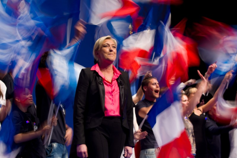 NICE, FRANCE - MARCH 30:  Supporters wave French flags as National Front leader Marine Le Pen campaigns ahead of the French elections on March 30, 2012 in Nice, France. The far-right candidate, who has recently slipped behind in opinion polls, is campaigning ahead of the April 22 election. According to reports Le pen,43, has been focusing her campaign on the recent shooting spree carried out by Mohamed Merah in south-western France  (Photo by Frederic Nebinger/Getty Images)