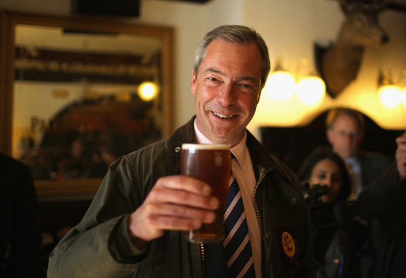 "SOUTH SHIELDS, ENGLAND - APRIL 30:  UK Independence Party (UKIP) Leader Nigel Farage enjoys a pint of beer after canvassing with the party's local candidate for South Shields on April 30, 2013 in South Shields, England. The UK Independence party leader, Nigel Farage, said that his party faced ""one or two teething problems"" with its 17000 candidates for Thursday's local elections after the suspension of UKIP candidate Alex Wood, who was photographed making a Nazi salute.  (Photo by Christopher Furlong/Getty Images)"