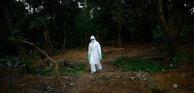 KENEMA, SIERRA LEONE - AUGUST 26:  A member of a volunteer medical team wears special uniform for the burial of 7 people, sterilized after dying due to the Ebola virus, in Kptema graveyard in Kenema, Sierra Leone on August 26, 2014. In recent months, Ebola  a contagious disease for which there is no known treatment or cure  has claimed at least 1429 lives in West Africa, mostly in Sierra Leone, Guinea and Liberia. (Photo by )