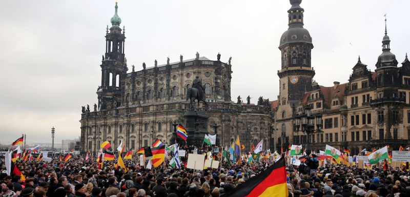 DRESDEN, GERMANY - DECEMBER 15 : Supporters of the Pegida (Patriotische Europaeer Gegen die Islamisierung des Abendlandes) movement stage protest with banners and German flags at the Theaterplatz Square in Dresden, Germany on January 25, 2015. (Photo by )