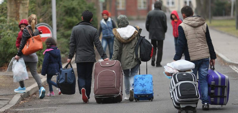 BERLIN, GERMANY - MARCH 11:  People pulling suitcases arrive at the Central Registration Office for Asylum Seekers (Zentrale Aufnahmestelle fuer Fluechtlinge, or ZAA) of the State Office for Health and Social Services (Landesamt fuer Gesundheit und Soziales, or LAGeSo), which is the registration office for refugees and migrants arriving in Berlin who are seeking asylum in Germany, on March 11, 2015 in Berlin, Germany. Germany, which registered over 200,000 refugees in 2014, is expecting even more in 2015 and many cities and towns are reeling under the burden of having to accommodate them. The main countries of origin of the refugees include Syria, Serbia, Eritrea, Afghanistan, Iraq, Kosovo and Albania.  (Photo by )