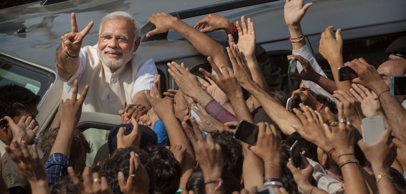 AHMEDABAD, INDIA - APRIL 30:  BJP leader Narendra Modi shows his inked finger to supporters as he leaves a polling station after voting on April 30, 2014 in Ahmedabad, India. India is in the midst of a nine phase election that began on April 7 and ends May 12.  (Photo by Kevin Frayer/Getty Images)