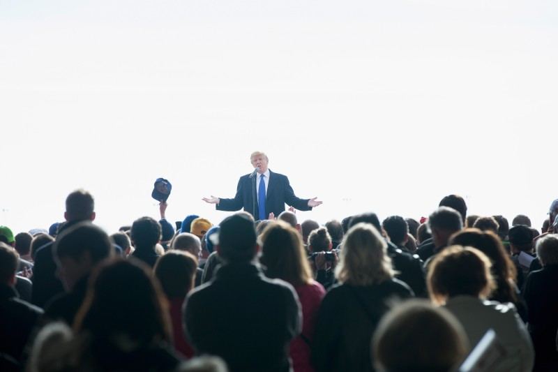 DUBUQUE, IA - JANUARY 30:  Republican presidential candidate Donald Trump speaks to guests during a rally at the airport on January 30, 2016 in Dubuque, Iowa. Trump is in Iowa trying to gain support in front of the state's February 1 caucuses.  (Photo by Scott Olson/Getty Images)