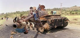 AMARA, ERITREA:  Eritrean children play 07 June 1991 on an Ethiopian army tank. The roadside was destroyed by Eritrean Liberation Front (EPLF) rebels in the battle for Amara, the capital city of Eritrea, that fell 20 May to EPLF rebels after 17 years of war. (Photo credit should read )