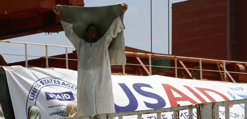 A Sudanese docker lifts his head cover as he unloads a US aid shipment organised by the US Agency for International Development and the World Food Programme at Port Sudan on the Red Sea coast, on May 5, 2016.  Dockers began unloading tens of thousands of tonnes of food from a US aid ship destined for war-torn areas of Sudan, an AFP correspondent reported. The bulk carrier Liberty Grace docked in Port Sudan with a cargo of 47,500 tonnes of sorghum, a staple food in Sudan.   / AFP / ASHRAF SHAZLY        (Photo credit should read ASHRAF SHAZLY/AFP/Getty Images)
