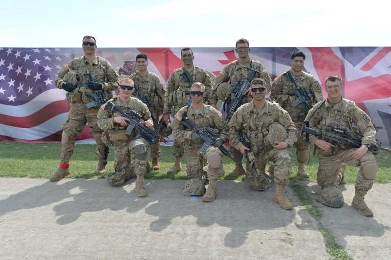 Members of the US units take a souvenir photo after the opening ceremony of the Exercise Noble Partner 16, a Georgian, British and U.S. military training exercise taking place at Vaziani Training Area, Georgia, May 11-26, 2016. Exercise Noble Partner includes approximately 500 Georgian, 150 United Kingdom and 650 U.S. service members who are incorporating a full range of equipment, including U.S. M1A2 Abrams Main Battle Tanks, M2A3 Bradley Infantry Fighting Vehicles, M119 Light Towed Howitzers and several wheeled support vehicles. Alongside U.S. forces, Georgian forces will operate their T-72 Main Battle Tanks, BMP-2 Infantry Combat Vehicles and several wheeled-support vehicles. Wednesday, 11 May 2016, in Vaziani, Georgia. (Photo by Artur Widak/NurPhoto via Getty Images)