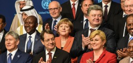 Chancellor Angela Merkel (C) applauds on May 23, 2016 during the World Humanitarian Summit family photo session in Istanbul. The over 60 heads of state and government gathered for the two-day summit convened by UN Secretary General Ban Ki-moon will have to defeat considerable scepticism that the event will turn into a well-intentioned but fruitless talking shop.  / AFP / OZAN KOSE        (Photo credit should read OZAN KOSE/AFP/Getty Images)