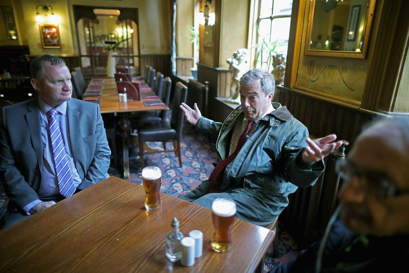 BOLTON, ENGLAND - MAY 25:  Leader of the United Kingdom Independence Party (UKIP), Nigel Farage enjoys a pint of beer during a break from campaigning for votes to leave the European Union on May 25, 2016 in Bolton, England. Nigel Farage took his battle bus to Bolton encouraging British people to vote to leave the EU on 23rd June 2016.  (Photo by Christopher Furlong/Getty Images)