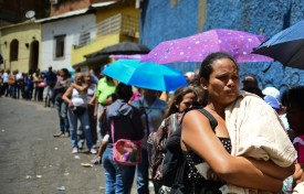 People line up to buy basic food and household items outside a supermarket in the poor neighborhood of Lidice, in Caracas, Venezuela on May 27, 2016. / AFP / RONALDO SCHEMIDT        (Photo credit should read RONALDO SCHEMIDT/AFP/Getty Images)