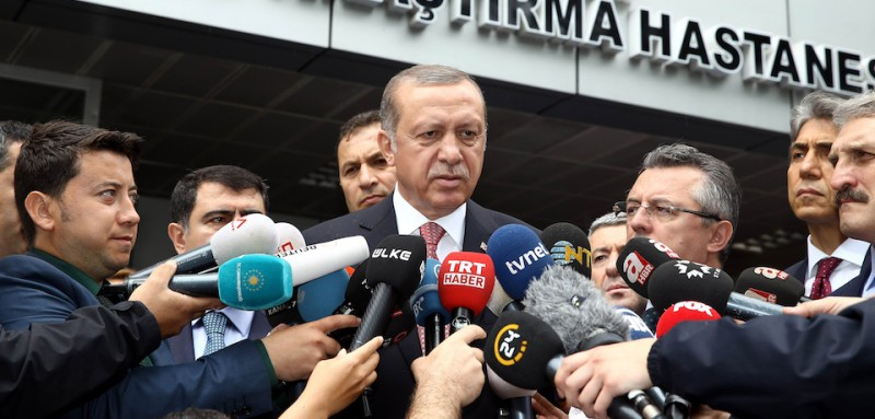 Turkey's President Recep Tayyip Erdogan speaks to the media outside the Haseki Training and Research Hospital in Istanbul on June 7, 2016 after visiting people injured by the blast of a bomb attack that targeted a police bus in the Vezneciler district of Istanbul earlier in the day. A bomb ripped through a Turkish police bus near Istanbul's historic centre, killing seven officers and four civilians and injuring 36 people in the latest of a string of attacks in Turkey's biggest city.  / AFP / YASIN BULBUL        (Photo credit should read YASIN BULBUL/AFP/Getty Images)