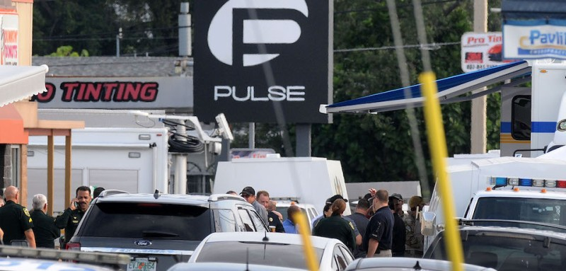 ORLANDO, FL - JUNE 12:  Orlando police officers seen outside of Pulse nightclub after a fatal shooting and hostage situation on June 12, 2016 in Orlando, Florida. The suspect was shot and killed by police after 20 people died and 42 were injured. (Photo by Gerardo Mora/Getty Images)