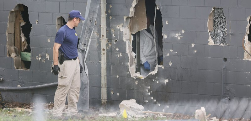 ORLANDO, FL - JUNE 12:  FBI agents investigate the damaged rear wall of the Pulse Nightclub where Omar Mateen allegedly killed at least 50 people on June 12, 2016 in Orlando, Florida. The mass shooting killed at least 50 people and injured 53 others in what is the deadliest mass shooting in the country's history.  (Photo by )