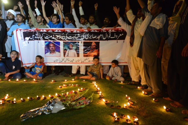 "Pakistani Shiite Muslim protesters shout slogans beside lighted oil lamp to pay tribute to Sufi musician Amjad Sabri who was killed in an attack by unknown gunmen, in Islamabad on June 22, 2016.   One of Pakistan's best known Sufi musicians was shot dead by unknown assailants riding a motorcycle in Karachi on June 22, triggering an outpouring of grief over what police described as an ""act of terror"". Amjad Sabri, aged around 45, was travelling by car from his home in the city's eastern Korangi area to a television studio, when a motorcycle pulled up alongside the vehicle and the attackers opened fire, Farooq Sanjarani, a police officer told AFP. / AFP / AAMIR QURESHI        (Photo credit should read AAMIR QURESHI/AFP/Getty Images)"