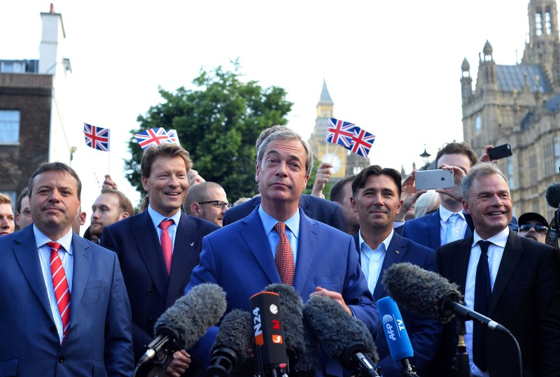 TOPSHOT - Leader of the United Kingdom Independence Party (UKIP), Nigel Farage (C) speaks during a press conference near the Houses of Parliament in central London on June 24, 2016. Britain has voted to leave the European Union by 51.9 percent to 48.1 percent, final results from all 382 of Britain's local counting centres showed on Friday. / AFP / GLYN KIRK        (Photo credit should read GLYN KIRK/AFP/Getty Images)