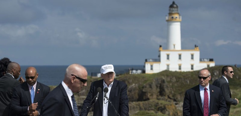 "TOPSHOT - Security guards flank Presumptive Republican presidential nominee Donald Trump (C) as he delivers a speech as he officially opens his Trump Turnberry hotel and golf resort in Turnberry, Scotland on June 24, 2016.  Donald Trump hailed Britain's vote to leave the EU as ""fantastic"" shortly after arriving in Scotland on Friday for his first international trip since becoming the presumptive Republican presidential nominee. / AFP / OLI SCARFF        (Photo credit should read )"