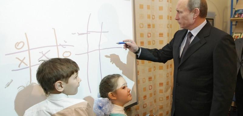 Russian Prime Minister Vladimir Putin (R) plays a game of tic-tac-toe (noughts and crosses) with schoolchildren during a visit to a library in Tyumen on February 26, 2010. Putin made a routine working visit to the city and surrounding region.  AFP PHOTO / RIA NOVOSTI / POOL / ALEXEY NIKOLSKY (Photo credit should read ALEXEY NIKOLSKY/AFP/Getty Images)