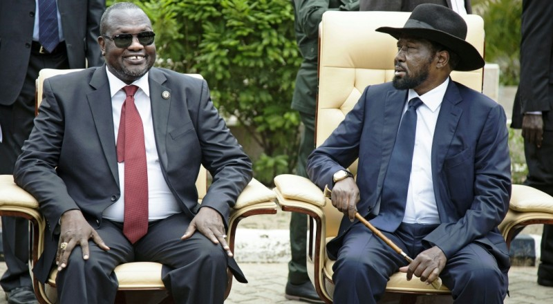 First Vice President of South Sudan and former rebel leader, Riek Machar (L), and President Salva Kiir (R), sit for an official photo with the 30 members of the new cabinet of the Transitional Government at the Cabinet Affairs Ministry, in Juba on April 29, 2016.  The new cabinet of the Transitional Government includes former rebels and members of the opposition, a step forward in a drawn-out peace process aimed at ending more than two years of conflict.  / AFP / ALBERT GONZALEZ FARRAN        (Photo credit should read ALBERT GONZALEZ FARRAN/AFP/Getty Images)
