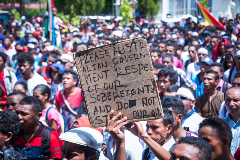 East Timorese activists attend a rally outside the Australian embassy in Dili on February 23, 2016. Hundreds of East Timorese activists held a rally on February 23 calling on the Australian government to negotiate for the establishment of permanent maritime boundaries between Australia and East Timor. AFP PHOTO / VALENTINO DARIEL SOUSA / AFP / VALENTINO DARIEL SOUSA        (Photo credit should read VALENTINO DARIEL SOUSA/AFP/Getty Images)
