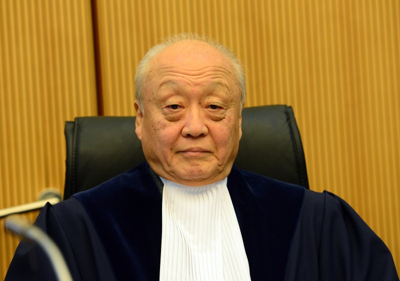 Shunji Yanai, president of the International Tribunal for the Law of the Sea (ITLOS), is pictured prior to the beginning of a hearing on a high-profile protest over Russia's detention of a Greenpeace Arctic Sunrise drilling ship and its crew brought by the Netherlands in Hamburg, Germany on November 6, 2013. Moscow has sparked international protests over its heavy-handed response after two Greenpeace activists in September 2013 scaled a state-owned oil platform to protest against Russian energy exploration in the Arctic. AFP PHOTO / PATRICK LUX        (Photo credit should read PATRICK LUX/AFP/Getty Images)