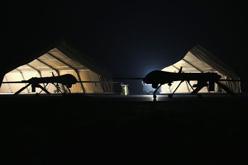 UNSPECIFIED, PERSIAN GULF REGION - JANUARY 07:  A U.S. Air Force MQ-1B Predator unmanned aerial vehicle (UAV), (R), returns from a mission to an air base in the Persian Gulf region on January 7, 2016. The U.S. military and coalition forces use the base, located in an undisclosed location, to launch drone airstrikes against ISIL in Iraq and Syria, as well as to transport cargo and and troops supporting Operation Inherent Resolve. The Predators at the base are operated and maintained by the 46th Expeditionary Reconnaissance Squadron, currently attached to the 386th Air Expeditionary Wing.  (Photo by John Moore/Getty Images)