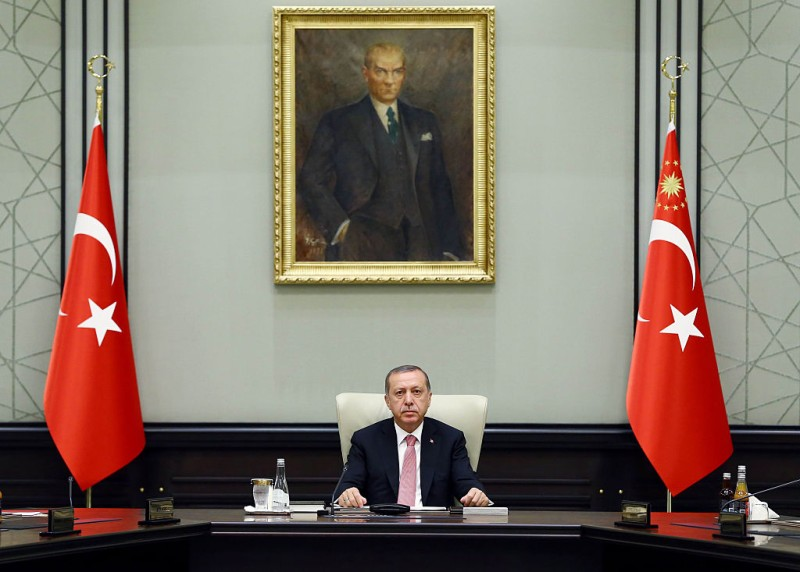 This handout picture taken and released on July 20, 2016 by Turkish Presidential Press Office shows Turkish President Recep Tayyip Erdogan chairing a meeting of the National Security Council (MGK) at the Presidential Palace in Ankara. Turkish President Recep Tayyip Erdogan today chaired a crunch security meeting for the first time since the failed coup, after a widening purge that has seen around 50,000 people either detained or sacked. / AFP / TURKEY'S PRESIDENTIAL PRESS SERVICE / KAYHAN OZER        (Photo credit should read KAYHAN OZER/AFP/Getty Images)